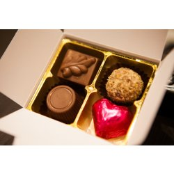 White box - 4 chocolates with one cerise heart $9.50 Contains 4 chocolates of your choice see The Menu or a ready made assortment including one cerisefoiled heart Ple. Please Click the image for more information.
