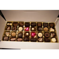 White gift box - 32 chocolates with cerise hearts $62.50 Contains 32 chocolates of your choice see The Menu or a ready made assortment with twofour cerisefoiled hearts Ple. Please Click the image for more information.