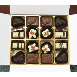 White box - 16 chocolates - Australian Christmas Selection $35.00 Contains 4 fruity  alcoholic Christmas Truffles 4 soft buttery caramels in milk chocolate 4 Tasmanian leatherwood honey  ginger ganaches in dark chocolate  4 roasted wattleseed ganache in white chocolate Someth. Please Click the image for more information.