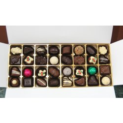 White box - 32 chocolates with 4 Christmas Truffles $62.50 Contains 32 assorted chocolatesincluding 4 Christmas Truffles Please Click the image for more information.