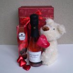 Puppy Love Gift Set Capture the playful spirit of love and the fun taste sensation of chocolate and pink champage when you send this Puppy Love Valentine gift set to your Valentine IncludesSoft puppy with red love tag 17cmJacobs Creek Sparkling Rose or Chardonnay Pinot Noir  200mlDroste Pastilles Dark Chocolate  100gIndividually wrapped red heart chocolates x 3Presented in a red gift box Please Click the image for more information.