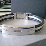 Stainless Steel Casual Bracelet A modern masculine piece for the man with subtly urban sensibilities  This stainless steel bracelet with two strands of black rubber give it a casual elegence and unique edgePre. Please Click the image for more information.