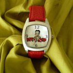 Betty Boop Watch This elegant and stylish Betty Boop watch is perfect for the Betty fan in your life  The Betty Boop Watch features a round silverstone case with a white watch face and red strap P. Please Click the image for more information.