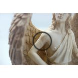 Archangel Uriel statue seconds Archangel Uriel statue in antique ivory finish The details are perfect on this statue but the arms have lines where they have been joined to the main statue . Please Click the image for more information.