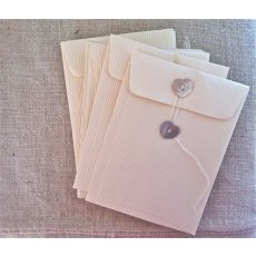10 pack small cream envelopes (pearl shell button)  Please Click the image for more information.