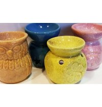 Ceramic Oil Burners These range of ceramic oil burners are sold in a wholesale display box of 20 pieces Please order in units of 20 . Please Click the image for more information.